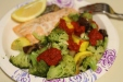 Baked salmon with sauteed veggies and red pepper sauce